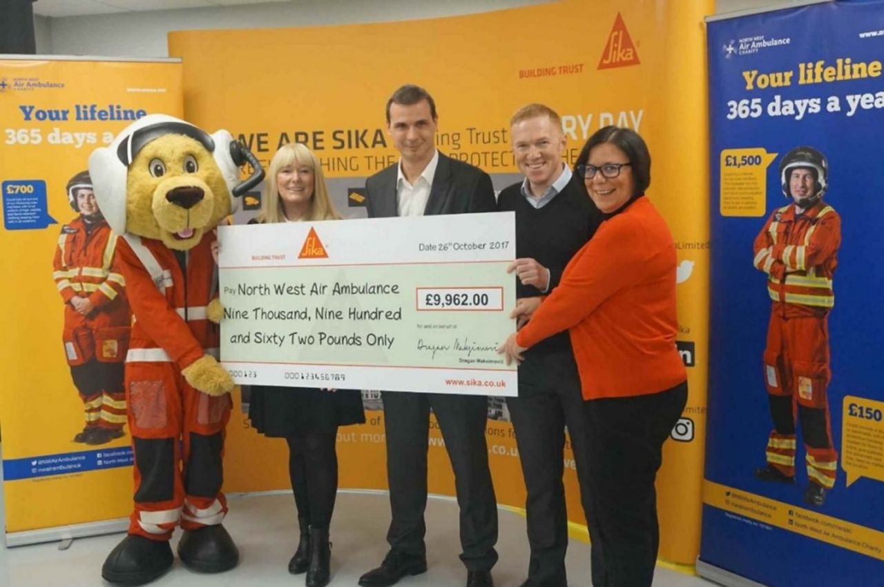 Dragan Maksimović, General Manager at Sika, presented Lynne Whittaker, Regional Fundraiser at NWAA, with a cheque at Sika's Preston site.