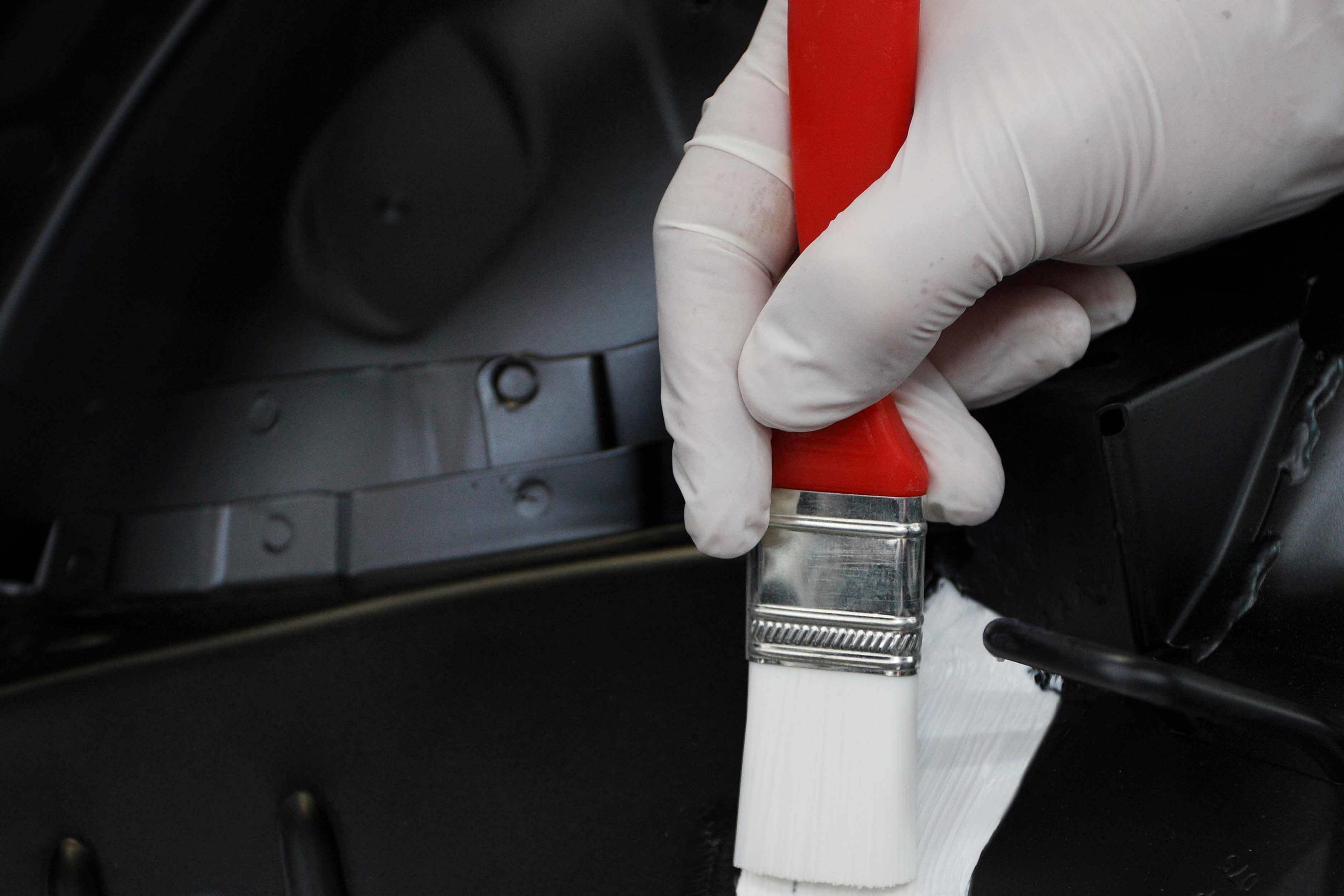 Sikaflex®-AT paint shop repair solution brushable seam application on vehicle