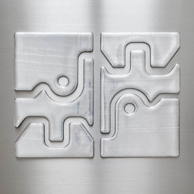Metal substrate with custom die cut constrained layer damping