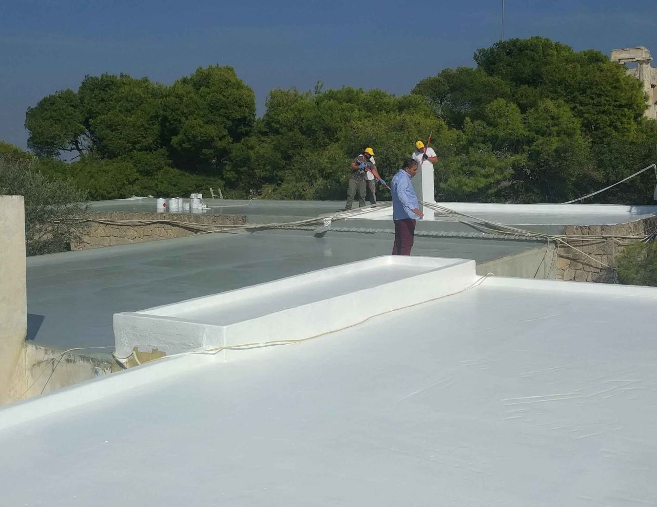 Sikalastic-701 applied on a cold roof in Greece