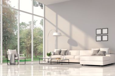 Modern living room interior 3d render.The Rooms have white floors and gray wall.furnished with white fabric furniture.There are large window. Overlooks to nature view.