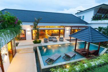 A modern island villa with open living room, swimming pool, gazebo