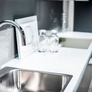 A kitchen food preparation counter with a dishwashing sink.