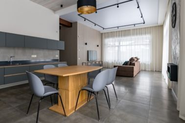 Grey kitchen furniture. Built-in household techie. Black with a gold chandelier over the table. panoramic windows. Light interior. Ceiling sweats. Modern furniture for the dining room.