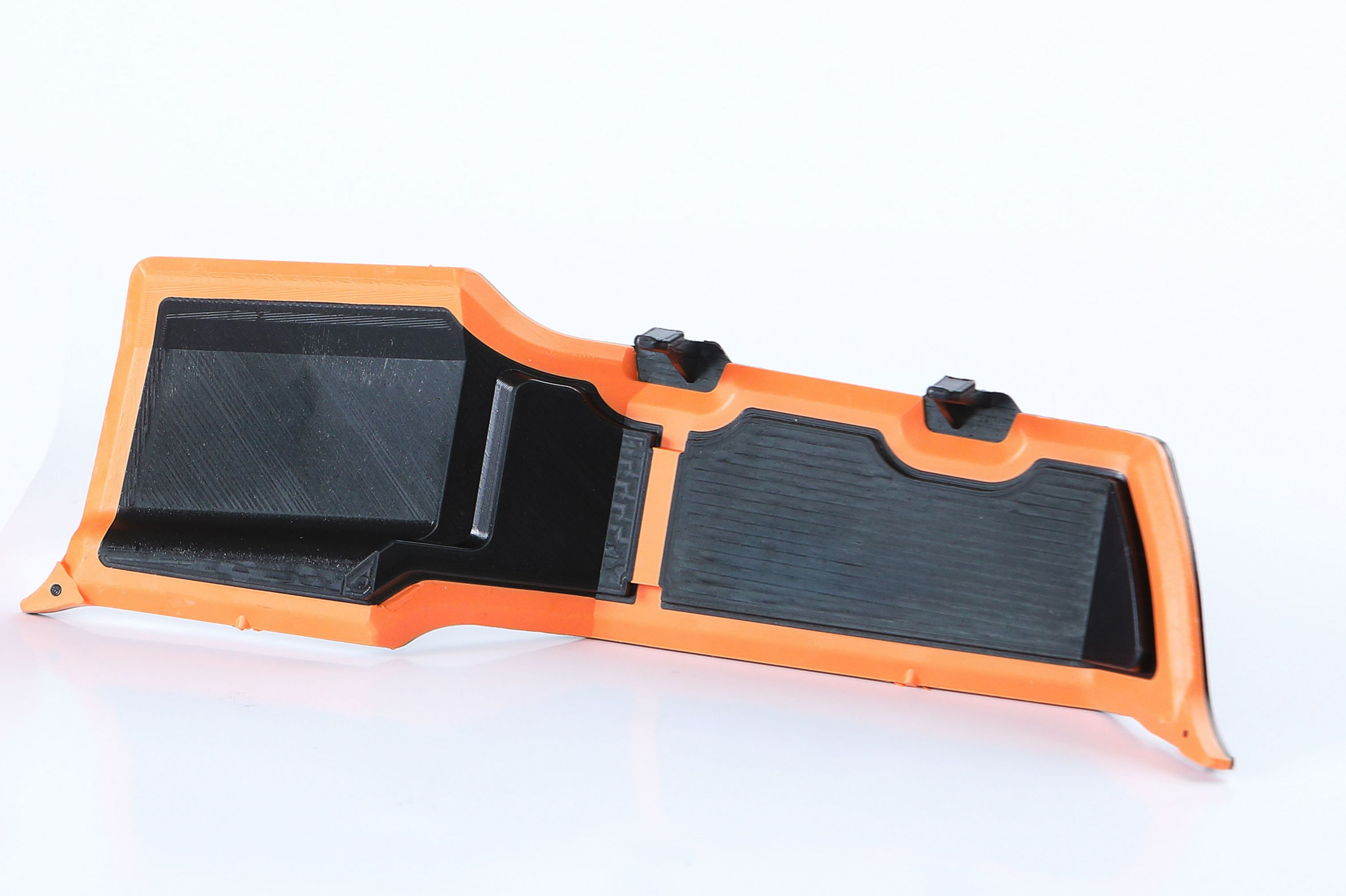 Injection molded acoustic SikaBaffle with attachment features