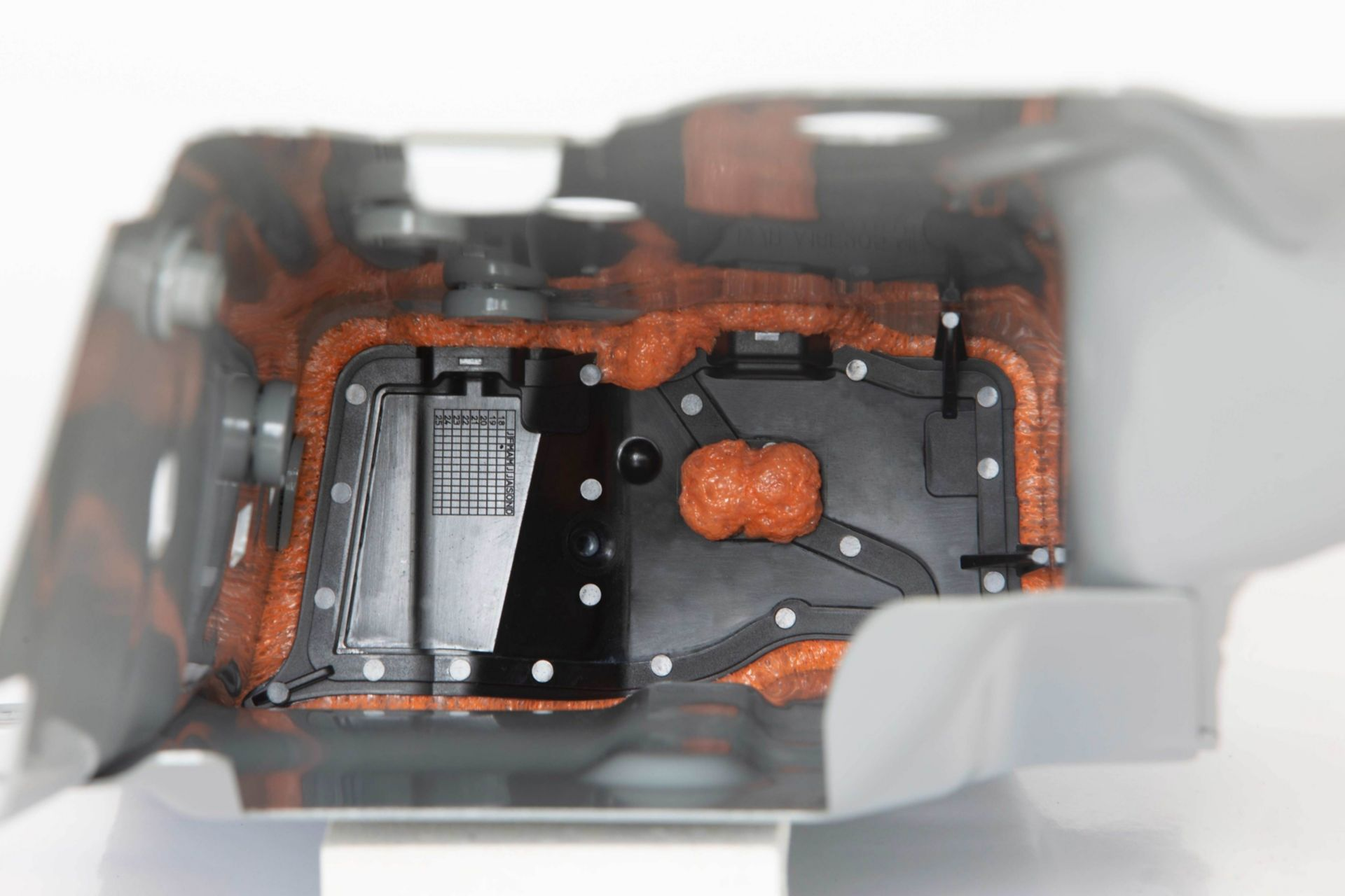 Injection molded, heat expanded, acoustic SikaBaffle in vehicle body cavity