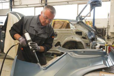 Car body repair with adhesive in a car factory