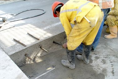 Man Applying Sika AnchorFix at a construction
