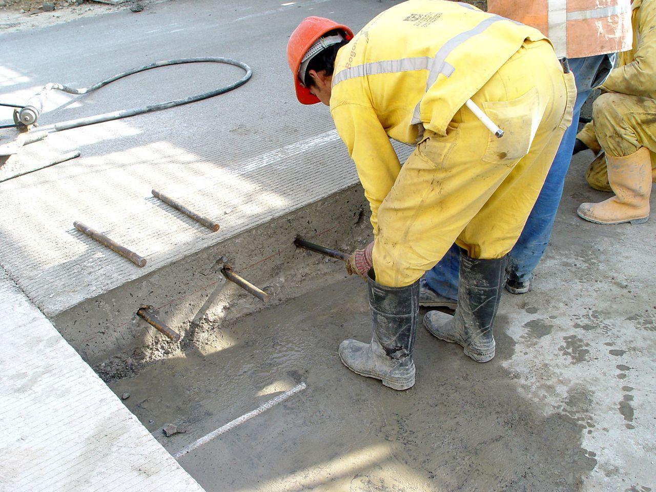 Man Applying Sika AnchorFix at a construction