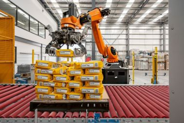Robots prepare packed mortar for onward transportation. The fully automated procedures lower production costs.