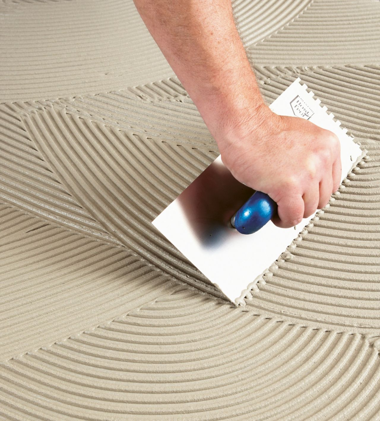 Application of tile adhesives