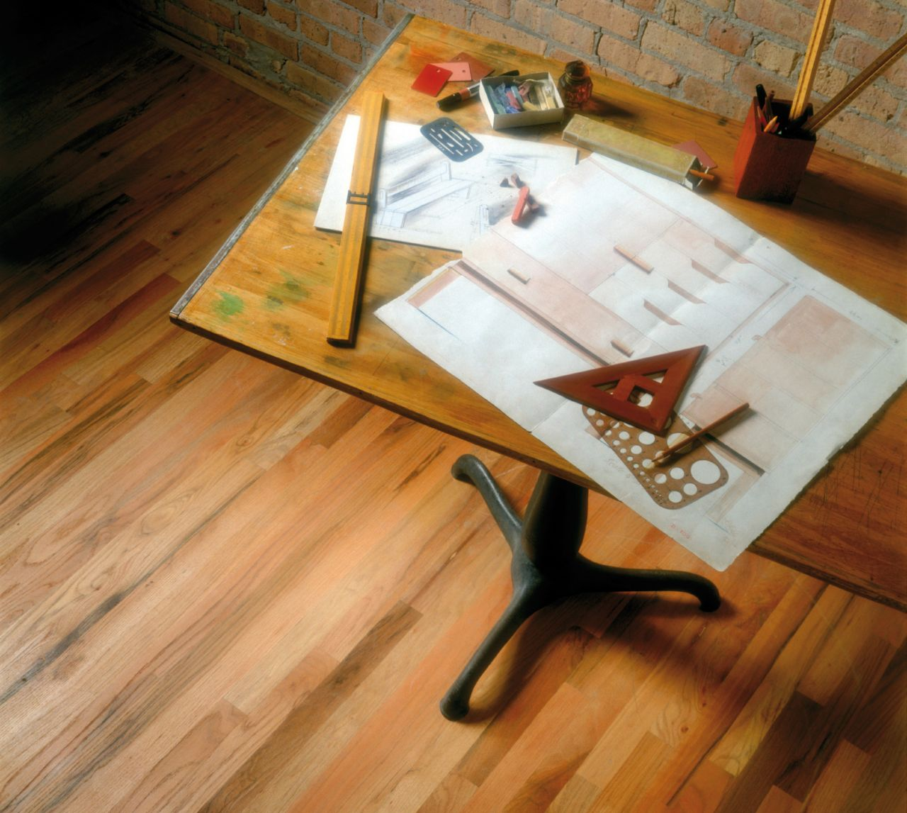 Architect's office and blueprint on desk with wood floor