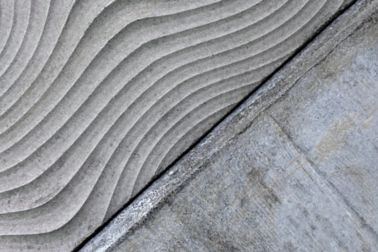 Architectural textured concrete wall produced with Costar concrete admixtures at Limmat building in Zurich