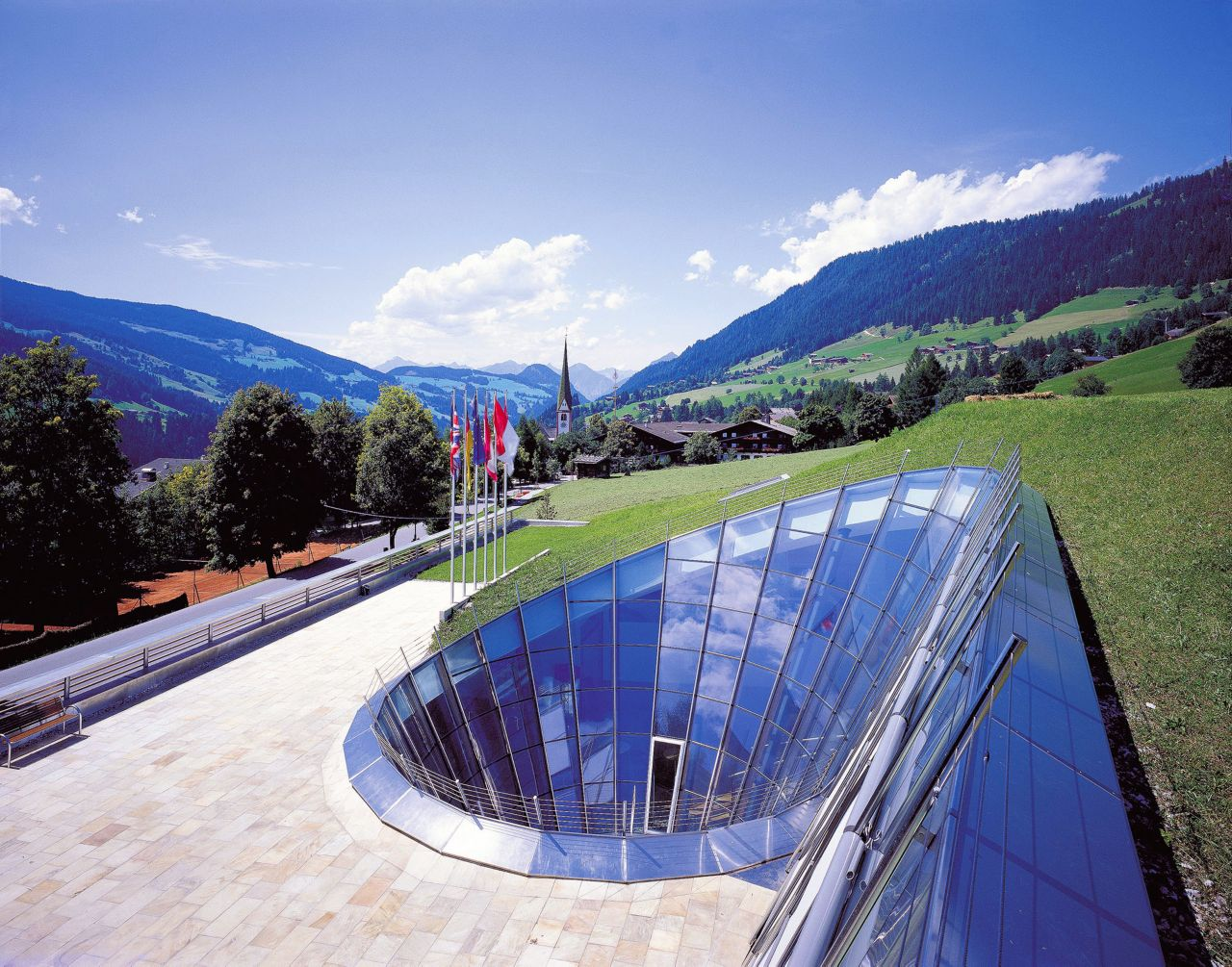 Builiding with green roof in the mountains