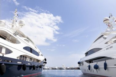Two ships next to each other on a pier