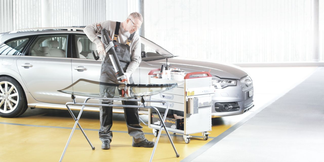 Automotive Aftermarket auto glass replacement application with a manual gun containing adhesive