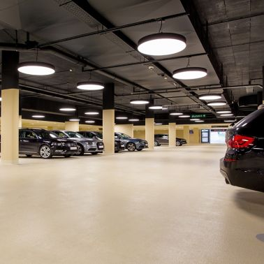 Cars in indoor parking garage made with Sikafloor coating system
