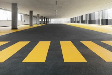 Colorful floor coating in car parking garage