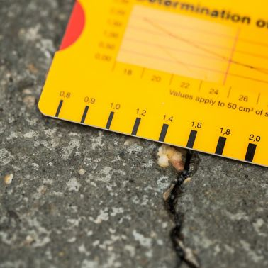 1,6 mm wide crack on the floor of a parking garage