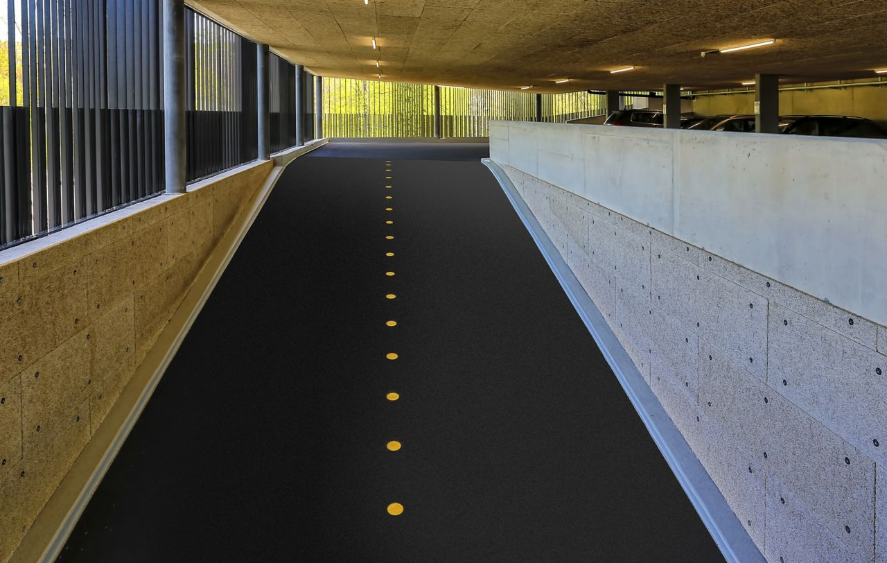Car park ramp with yellow dot divider in parking garage in Switzerland