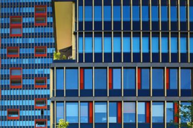 Highrise red and yellow facade with weather sealing glazing