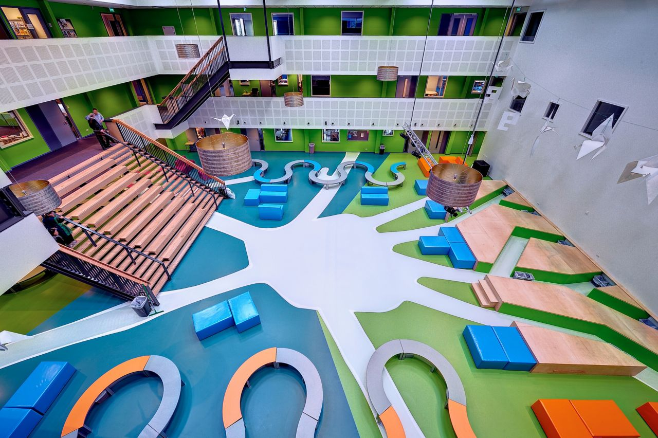 Sika ComfortFloor® blue and green floor at Revius Lyceum school lobby in Netherlands