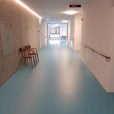 Sika ComfortFloor® blue floor in hospital hallway in Switzerland