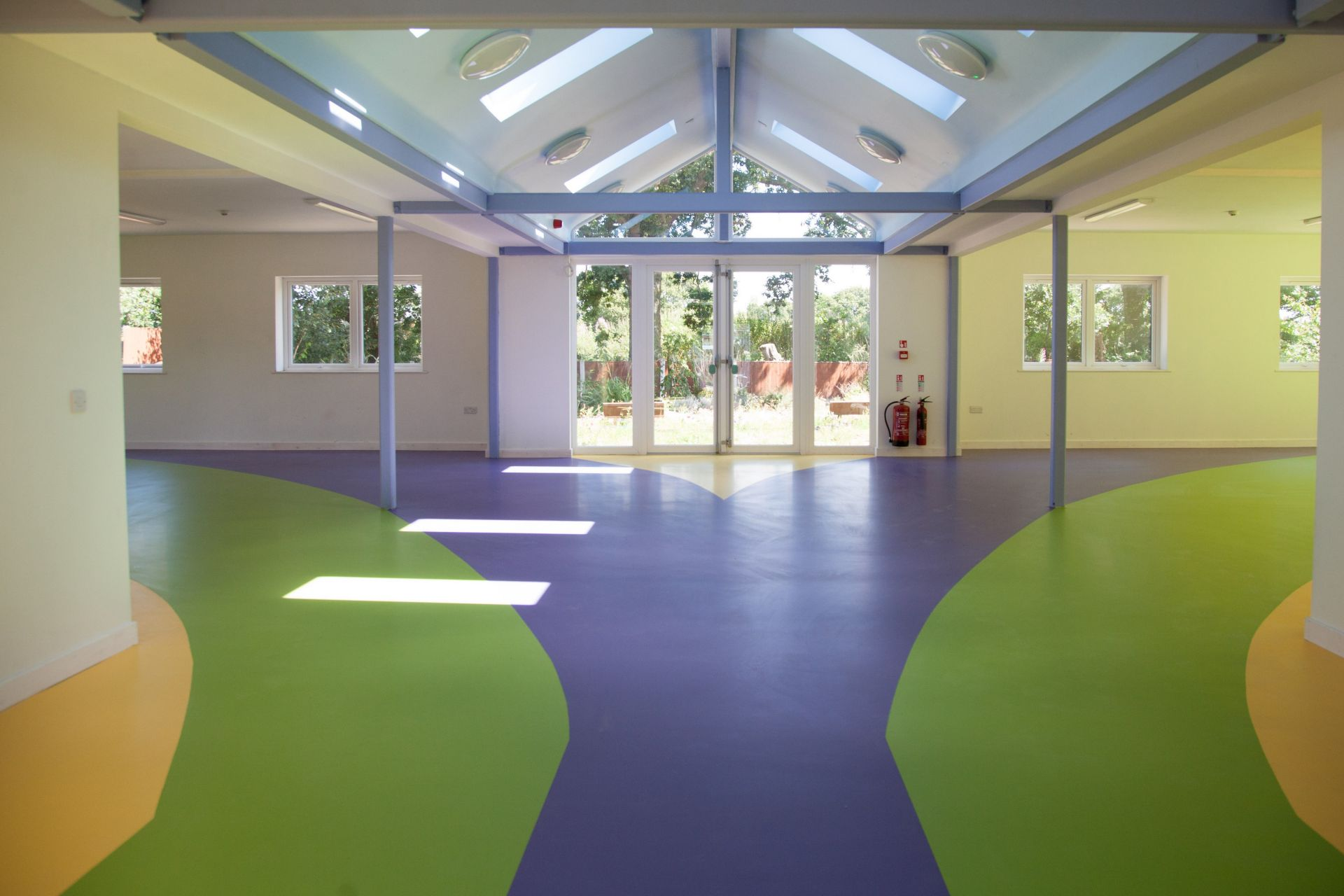 Sika ComfortFloor® blue, green, yellow floor at Rainbow House Charity in UK