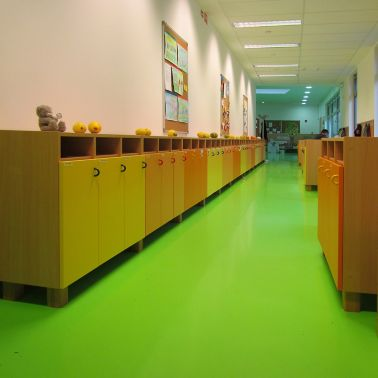 Sika ComfortFloor® green floor at kindergarden in locker hallway
