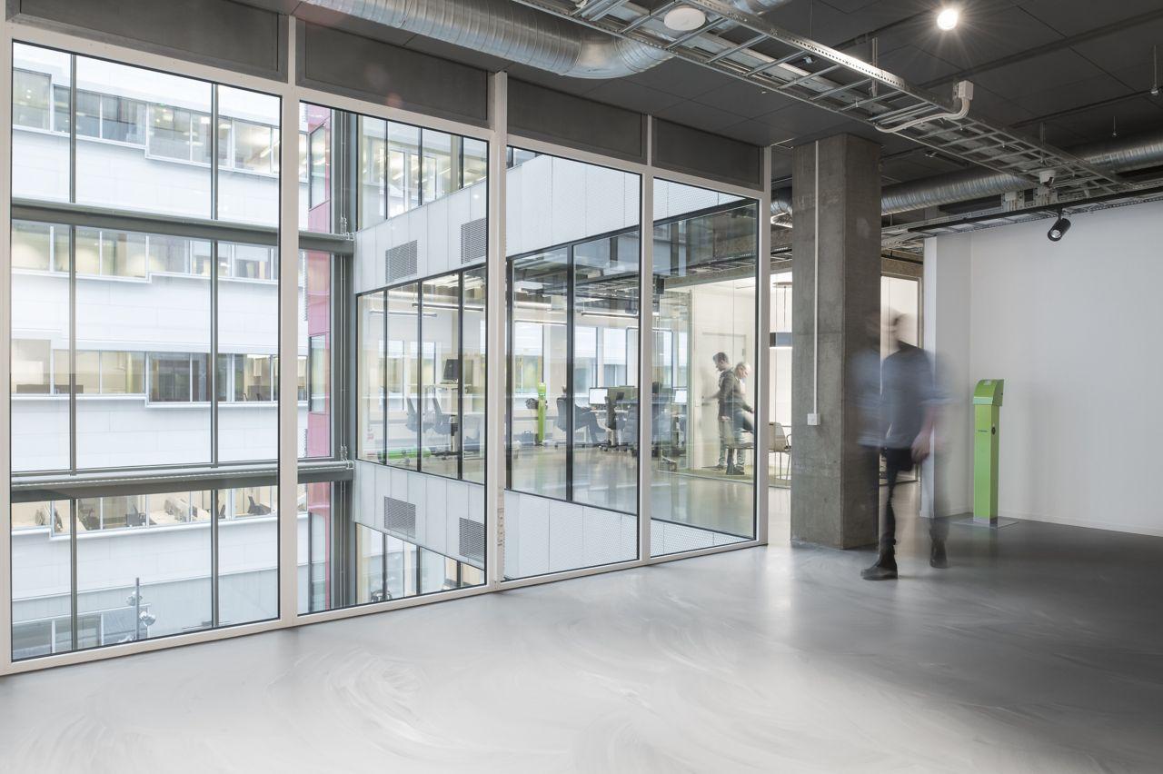 Sika ComfortFloor® grey marbled floor in office hallway