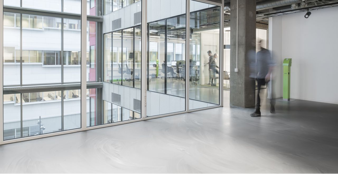 Sika ComfortFloor® grey marbled floor in office hallway