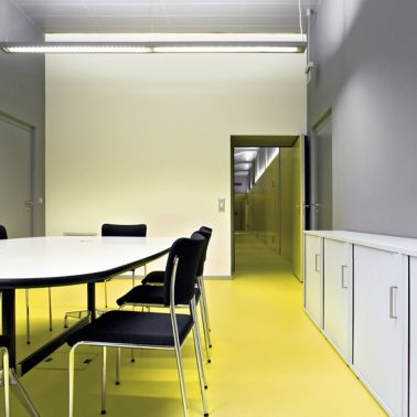 Sika ComfortFloor® yellow floor in office meeting room