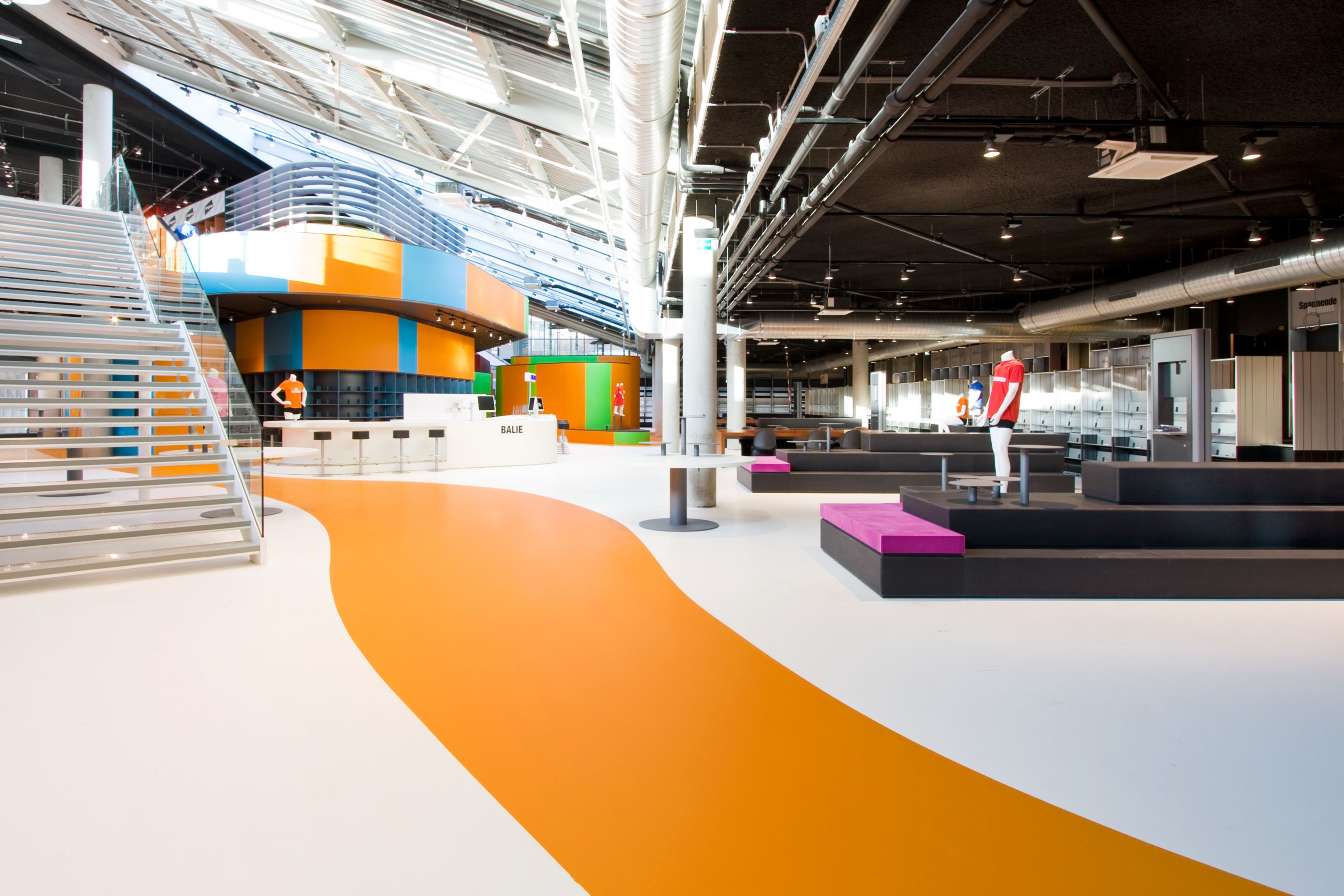 Sika ComfortFloor® orange and white floor in retail shop in Lelystad, Netherlands