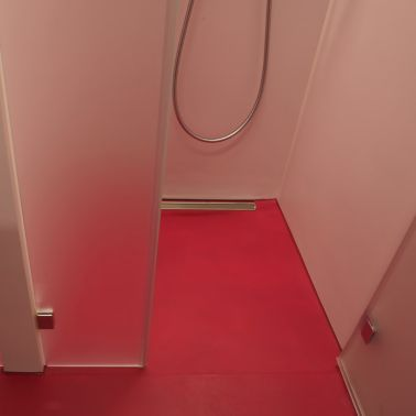 Sika ComfortFloor® pink bathroom shower in modern office building