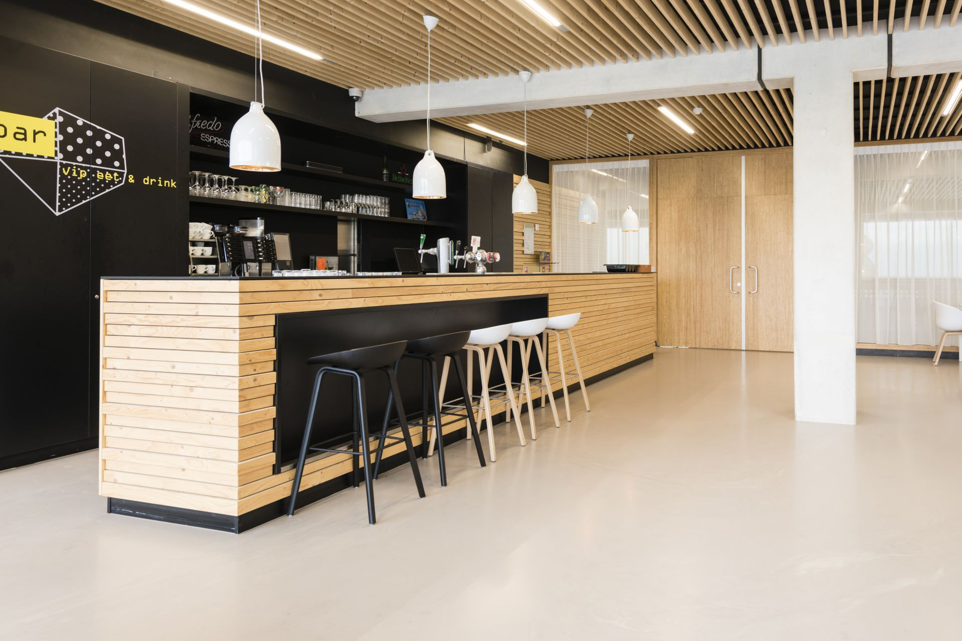 Sika ComfortFloor® beige grey floor in cafe at Sportcomplex Willem Alexander in Hoofddorp, Netherlands