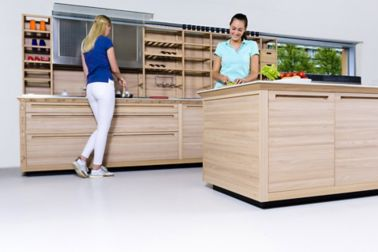 Sika ComfortFloor® white floor in modern kitchen with ladies cooking