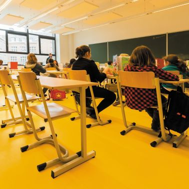 Sika ComfortFloor® yellow floor at school classroom with kids