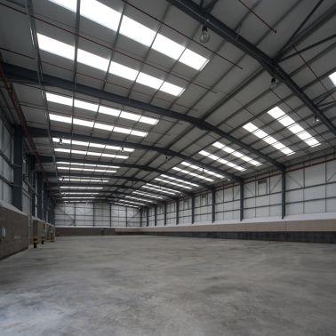 Concrete slab on grade floor in warehouse with SikaFiber fibers