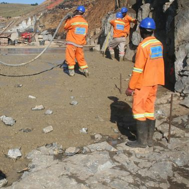 Workers pouring concrete produced with Sika admixtures