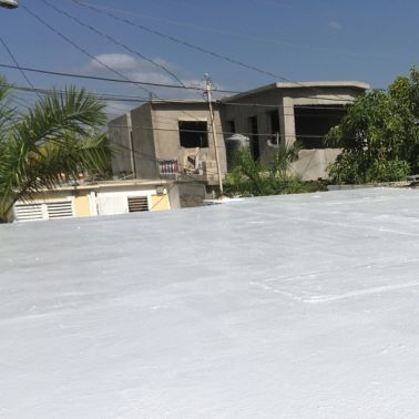 White membrane of cool roof system on residential building