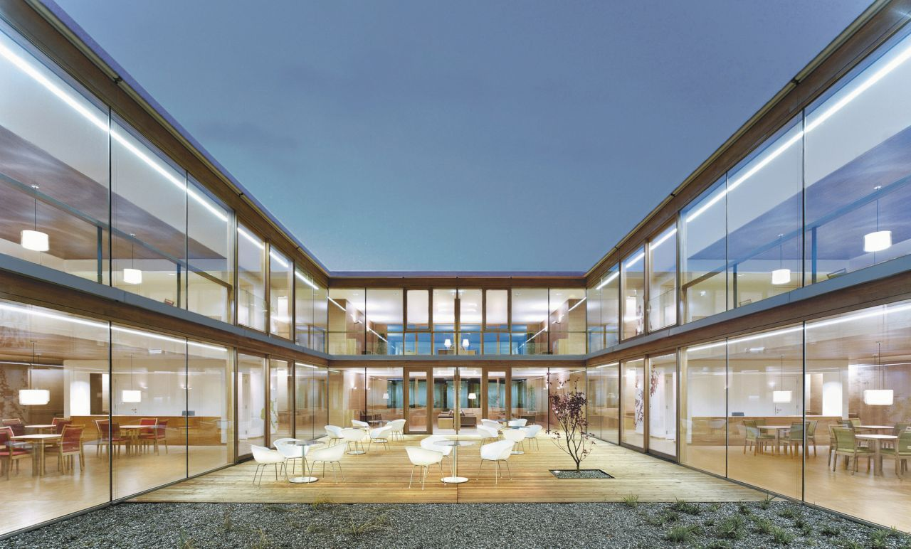 Seating area on terrace courtyard with glass facade