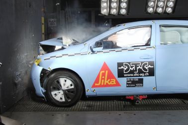 A crash test with a car is being performed to ensure the car windshield is staying in place