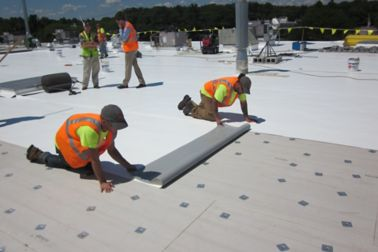 Workers applying Sika Roofing Solutions on a data center