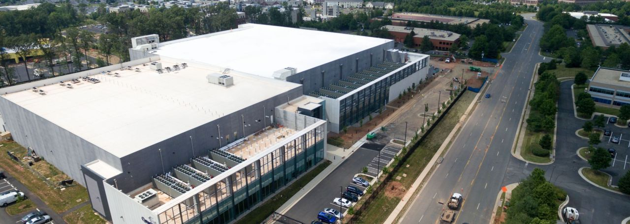 White cool roof being built over a data center
