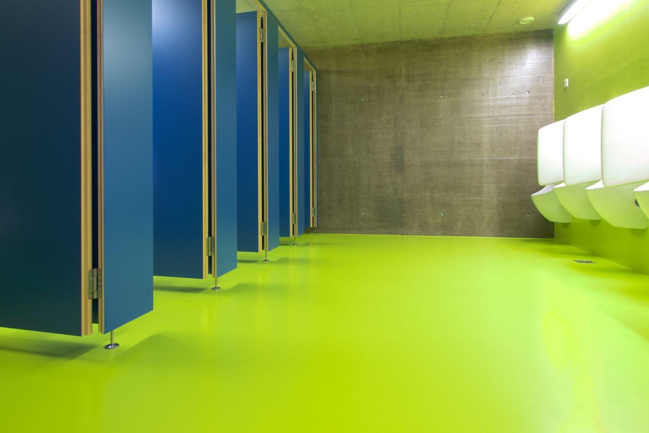Decorative bathroom floor with Sikafloor at Seeblick Sport Center in Switzerland