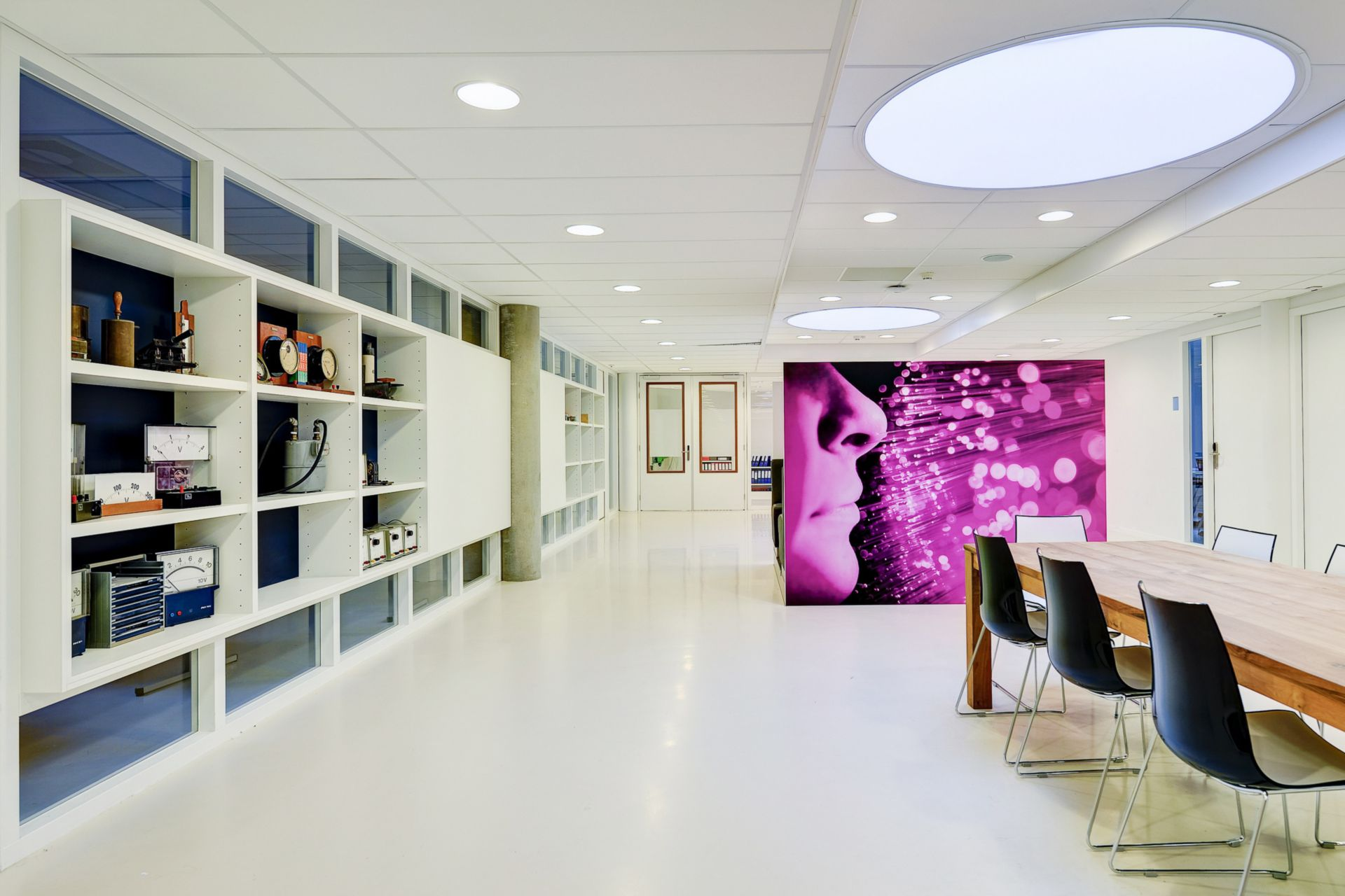 Decorative white floor made with Sika ComfortFloor system at Aloysius College in Hilversum, Netherlands