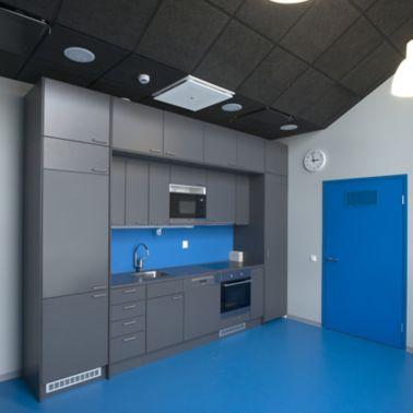 Decorative blue floor grey kitchen at Kokkola campus hall school in Finland with Sika ComfortFloor system