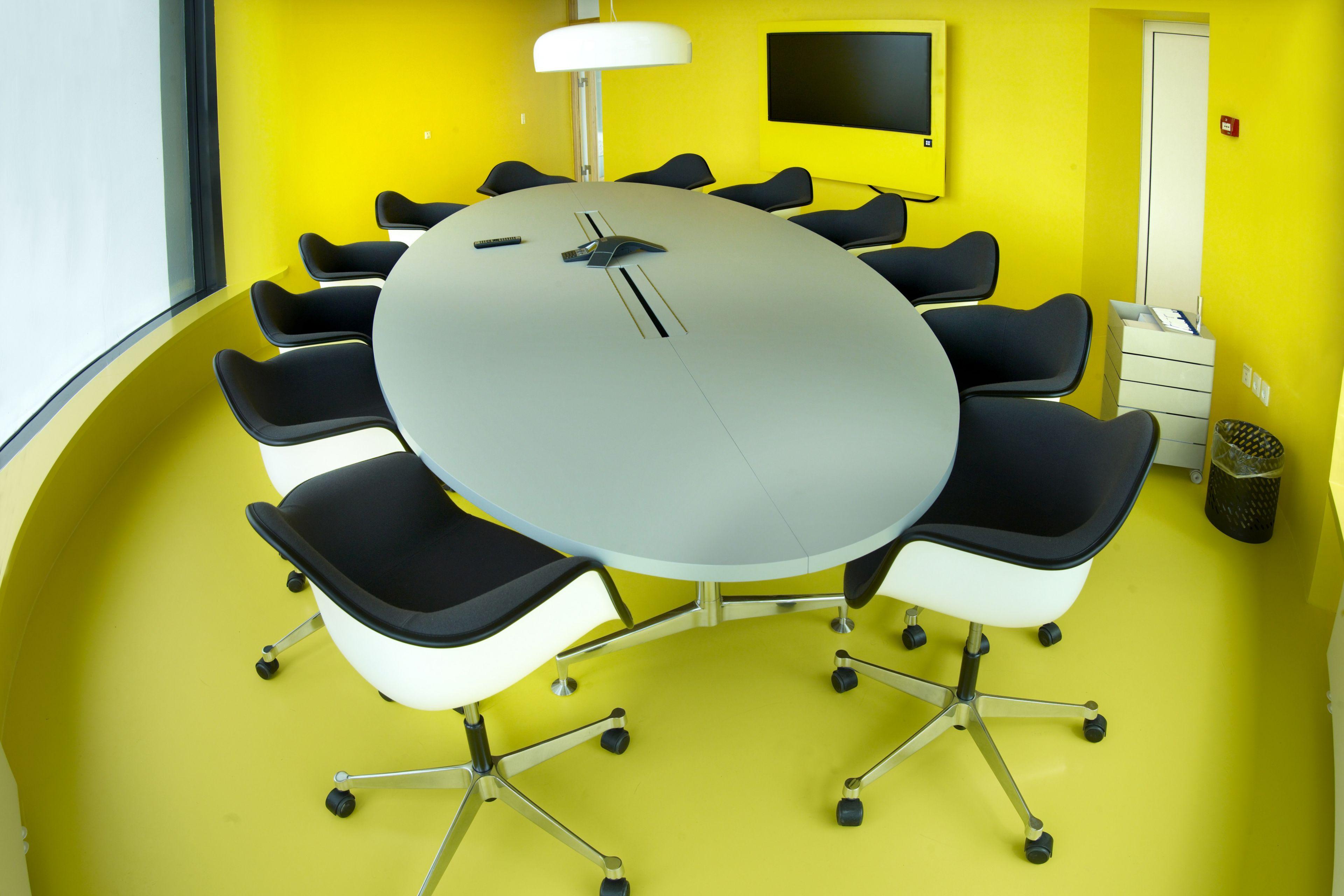 Decorative yellow floor in office meeting room