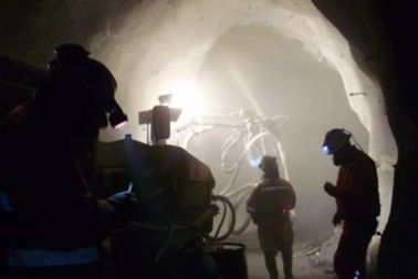 Workers applying Sika Shotcrete in the El Teniente Mine in Chile