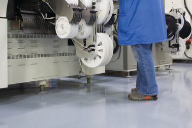 Man standing on industrial floor covered with Sikafloor ESD flooring system